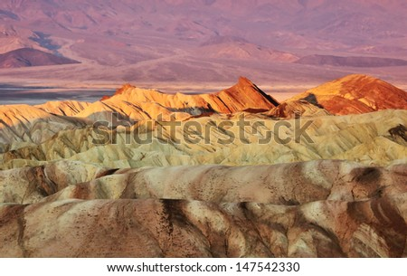 Colorful sunrise of Zabriskie Point, Death Valley, California, USA - Shutterstock ID 147542330