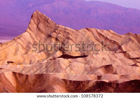 Colorful sunrise of Zabriskie Point peak Death Valley California