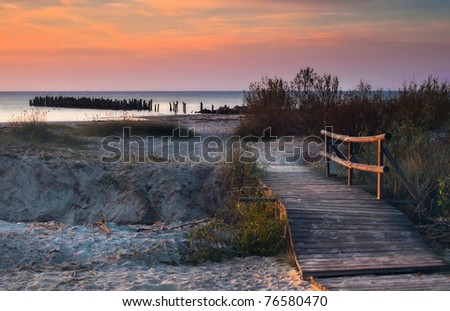 Colorful sunrise on the beach of Riga gulf, Latvia