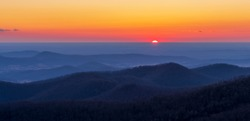 Colorful sunrise over mountains in winter