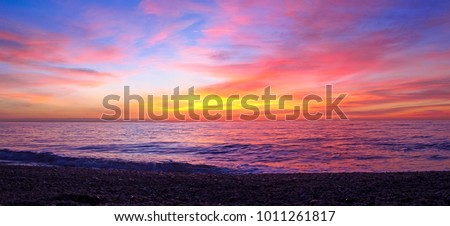 Colorful sunrise over the beach in the mediterranean sea in the south coast of Spain #1011261817