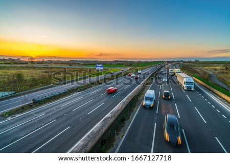 Colorful sunset at M1 motorway near Flitwick junction with blurry cars in United Kingdom Stock photo ©