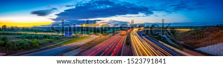 Colorful sunset at M1 motorway near Flitwick junction with cars light trails. United Kingdom Stock photo ©
