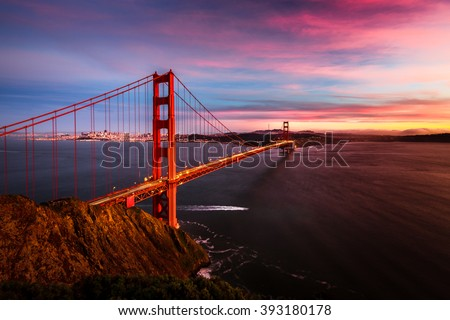 Colorful sunset at the Golden Gate Bridge in San Francisco, California, USA #393180178