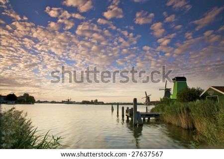 Colorful sunset in Holland with windmills and canals