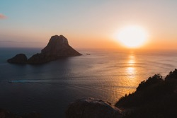 Colorful sunset looking over to the sea from a lookout point in Ibiza