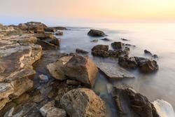 Colorful sunset on a beach with rocks on the Adriatic Sea coast Istria Croatia