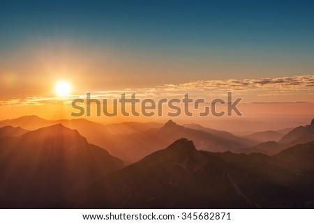 colorful sunset on top of austrian mountain alps #345682871