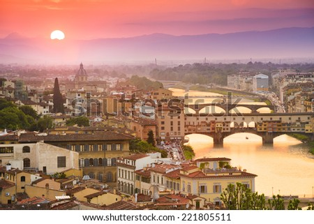 Colorful sunset over Ponte Vecchio on Arno River, Florence, Italy stock photo
