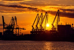 Colorful sunset over sea port and industrial cranes, Varna, Bulgaria