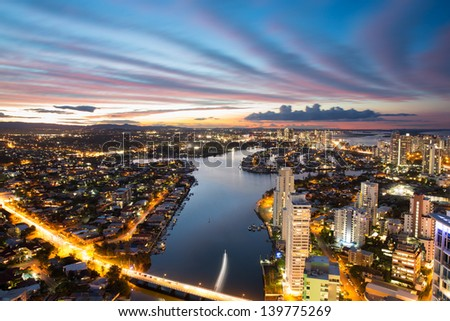 Colorful sunset over suburbs, Gold Coast, Australia