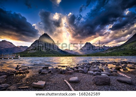 Colorful sunset over Swiftcurrent Lake in Glacier National Park, Montana