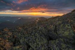 Colorful sunset over the mountains. After rain fog. Vladeasa, Apuseni Natural Park, Transylvania, Romania