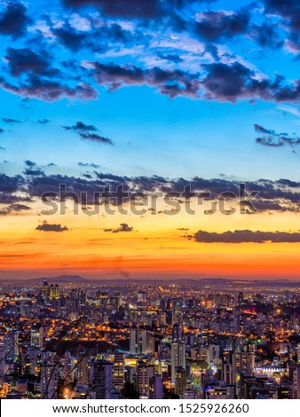 Colorful Sunset Sky and Cityscape of Belo Horizonte along with the Moon in Minas Gerais State, Brazil (Vertical Image)