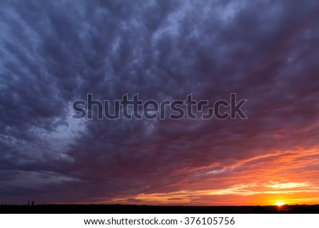 colorful sunset with clouds in...