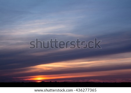 Colorful sunset with clouds in the evening #436277365