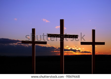 Colorful sunset with three crosses - stock photo