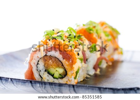 Colorful sushi roll with sashimi grade spicy ahi tuna for Sashimi grade fish