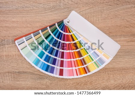 Colorful swatch on wooden table close up