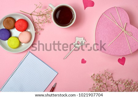 Colorful sweet macaroons and a cup of tea. Delicious breakfast.Sheet of paper for romantic stories. #1021907704