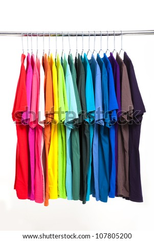 colorful t-shirt with hangers isolated on white - stock photo