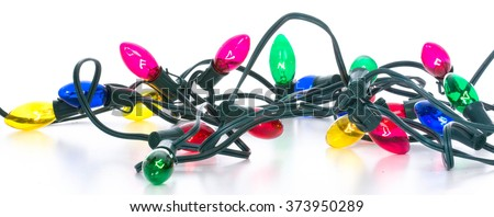 colorful tangled christmas lights on white background
