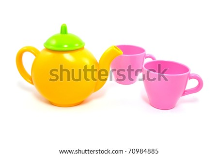 colorful teapot and cups over a white background