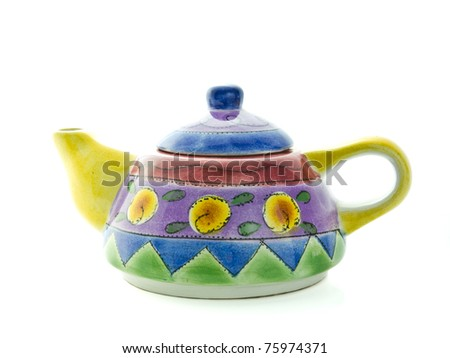 Colorful teapot painted by hand isolated on white background