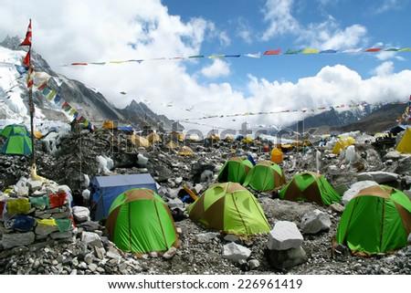 Colorful tents and Tibetan prayer flags at Everest Base Camp, Khumbu Region, Nepal.