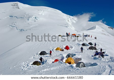 Colorful tents in high snowy mountains, (Refuge du Goater) halfway up Mont Blanc in France #66661180