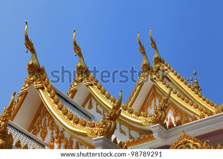 colorful Thai temple roof - stock photo