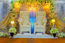 Colorful themed wedding stage.Malay Traditional Wedding.