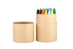 Colorful thin wax crayons set in an open eco friendly brown paper tube packaging, simple crayon paper box object isolated on white, cut out. School supplies, drawing accessories, education, creativity