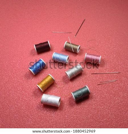 Colorful thread cones and needles closeup Stok fotoğraf ©