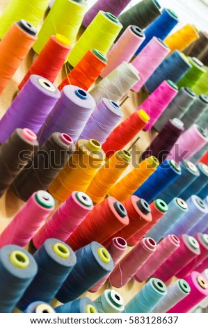 Shutterstock Colorful thread spools used in fabric and textile industry. The concept of sewing production.