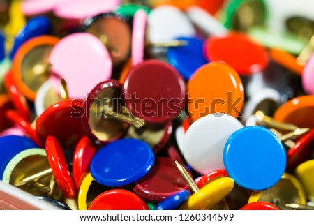 Colorful thumbtacks close up macro shot, shallow depth of field, image for background.
