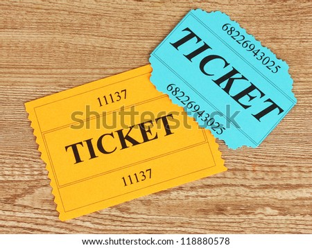 Colorful tickets on wooden background close-up