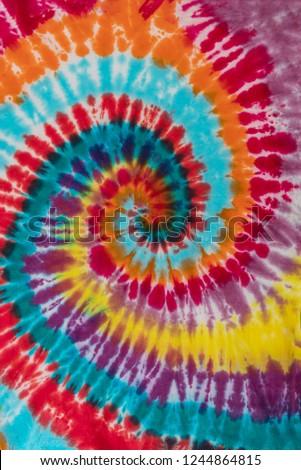 Colorful Tie Dye Traditional Swirl Pattern Design #1244864815