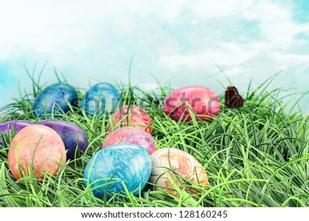 Colorful tie dyed Easter eggs in the grass. Extreme shallow DOF.