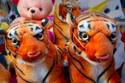 Colorful tiger pub dolls , handicraft products being sold at hastashilpomela or handicrafts fair at Kolkata, West Bengal, India