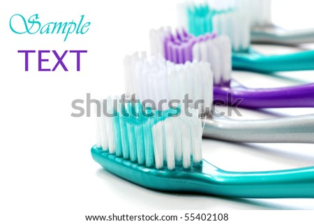 Colorful toothbrushes on white background with copy space.  Macro with shallow dof.