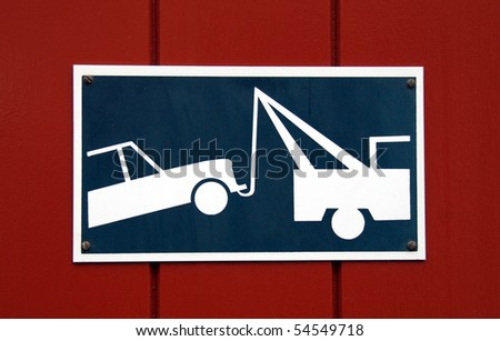 Colorful tow zone sign