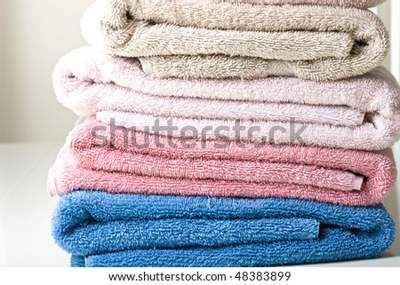 Colorful towels folded on a table close up