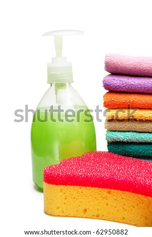 colorful towels, liquid soap and bath sponge isolated over white background - stock photo