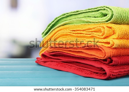 Colorful towels on light background