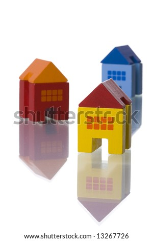 colorful toy houses isolated on white with reflection (selective and soft focus)