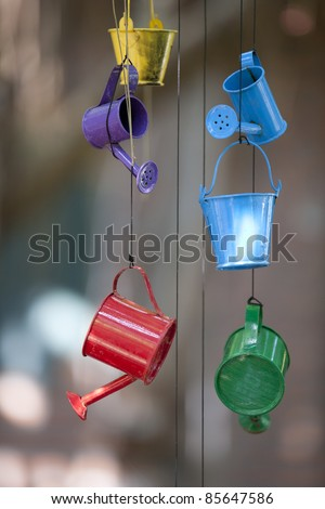 Colorful Toy of Pail and Watering Can hanging on the ceiling.