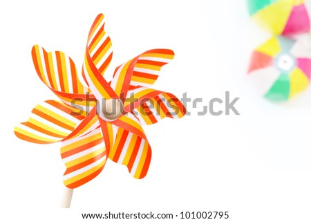 Colorful toy pinwheel on white background