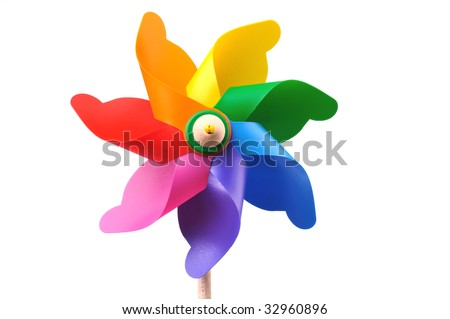 Colorful toy pinwheel windmill on white background, space for copy