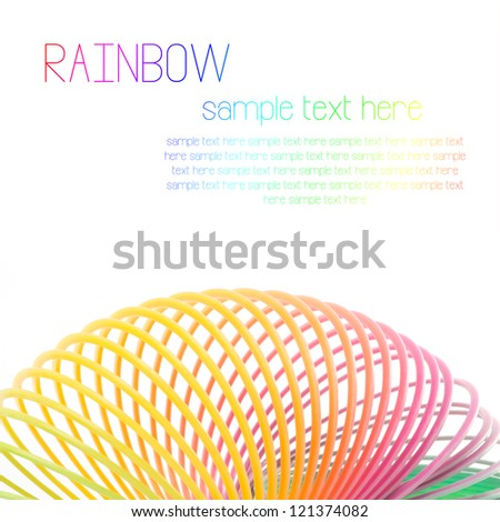 Colorful Toy Spring Rainbow On White Background